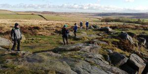 Hikers up Curbar Edge