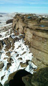 Climbers up Stanage Edge